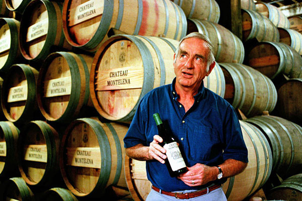 In this file photo, Jim Barrett, owner of Chateau Montelena, holds a bottle of the 1973 Chardonnay in Calistoga, Calif.
