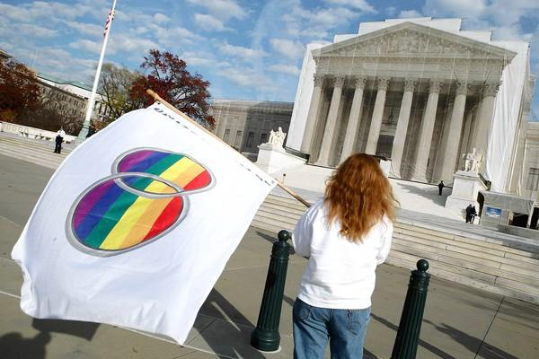Gay-rights demonstrators stand in front of the U.S. Supreme Court building in November.