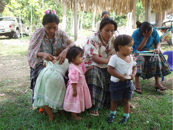 Q'eqchi indigenous health promoter practitioners trained by Concern America are seen here with children in Peten, Guatemala. Concern America is holding its 16th annual Walk Out of Poverty on Saturday in Fountain Valley.