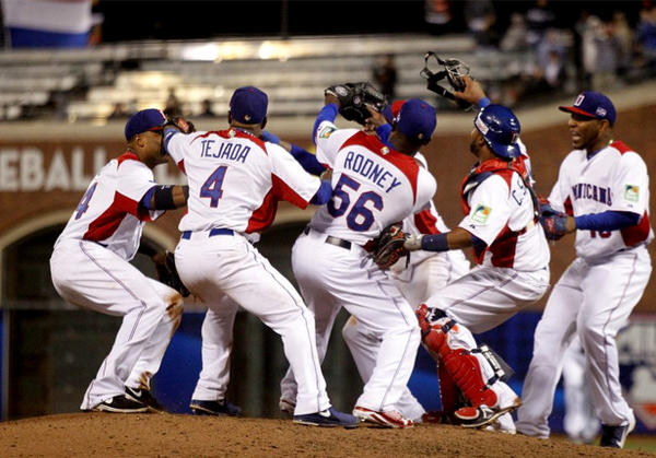 Members of the Dominican Republic team celebrate after winning their semifinal game against the Netherlands in San Francisco.