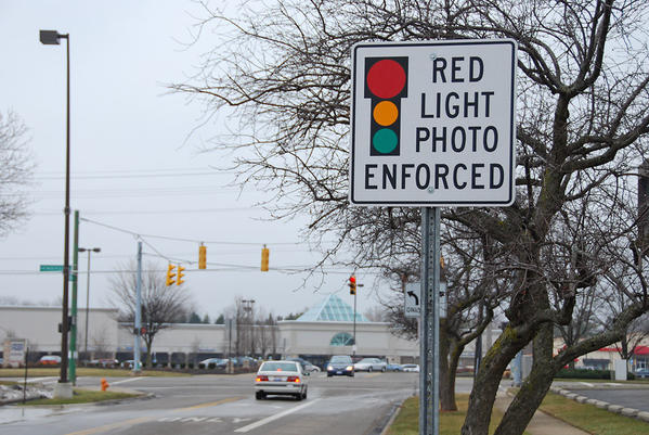 A sign warns of red-light cameras at the intersection ahead in Columbus, Ohio.