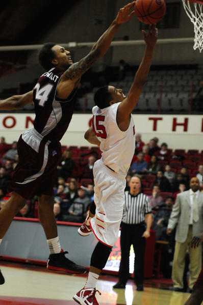 Rider University's Derrick Stewart (24) blocks a shot by University of Hartford's Yolonzo Moore II (15) during the first half. The University of Hartford played Rider University in the first round of the CollegeInsider.com Postseason Tournament, CIT, played at the University of Hartford.