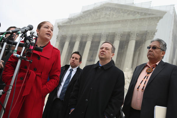Mexican American Legal Defense and Education Fund Director of Litigation Nina Perales, MALDEF lawyer Luis Figaroa, Georgetown University law professor Jon Greenbaum and San Carlos Apache Tribal Chairman Terry Rambler talk with reporters outside the U.S. Supreme Court after attending oral arguments in Arizona v. Inter Tribal Council et al.