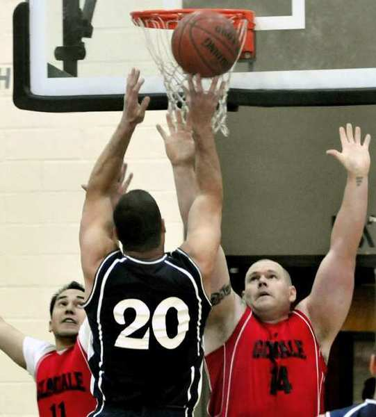 ARCHIVE PHOTO: Firefighters in blue and police officers in red, battle for the ball during Hoop Heroes basketball between Glendale Police and Fire Departments at Glendale High School. Sunday, April 1, 2012.