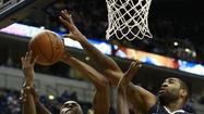 Orlando's Maurice Harkless and Kyle O'Quinn fight Indiana's Roy Hibbert for the ball during an NBA basketball game in Indianapolis.