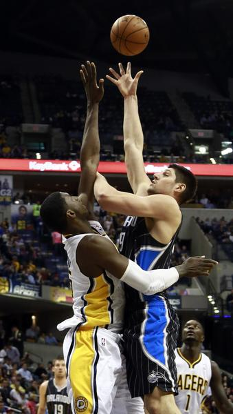 Orlando's Nikola Vucevic shoots over Indiana's Roy Hibbert during an NBA basketball game in Indianapolis.