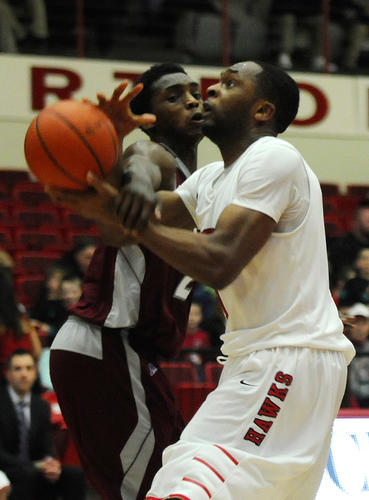 Rider University's Zedric Sadler (2) fouls University of Hartford's Mark Nwakamma (1) during the second half. The University of Hartford lost to Rider University in the first round of the CollegeInsider.com Postseason Tournament, CIT, played at the University of Hartford by a score of 63 to 54.