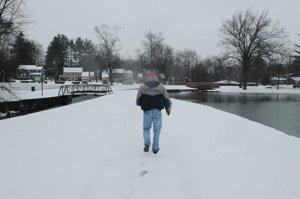 Joe Krukowski of Bloomfield leads the way to another geocache he found earlier at Fernridge Park in West Hartford.