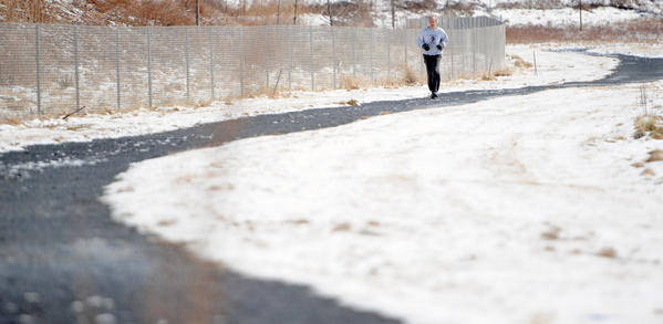 Dave Kuzma, of Lehighton and an employee at Air Products in Trexlertown, runs 4 miles on his lunch break on Tuesday.