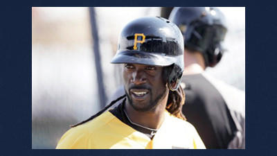Pittsburgh Pirates center fielder Andrew McCutchen stands outside the batting cage before a baseball spring training exhibition game in Bradenton, Fla.