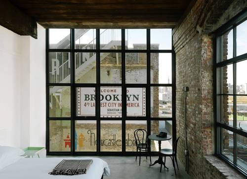 A room at the Wythe Hotel in Brooklyn. Wythe Hotel started with the discovery of a factory on the Williamsburg waterfront. The building was constructed in 1901 and has been converted into a 72-room hotel.