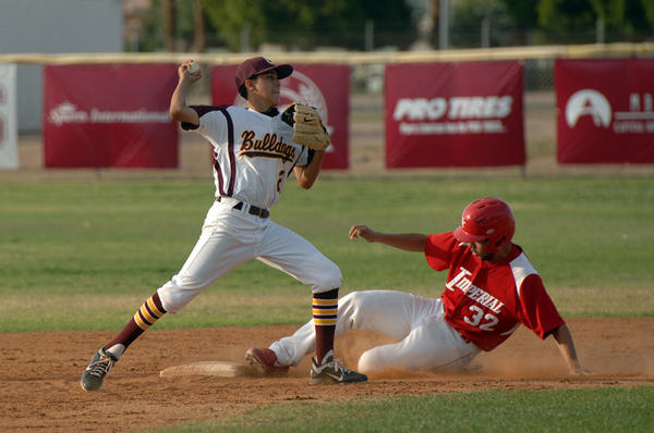 Calexico High¿s second baseman Steven Panela throws the ball to first base after tagging Imperial High¿s Ryan Spence in Calexico on Tuesday. .JOSELITO VILLERO PHOTO.Tuesday, March 19, 2013.