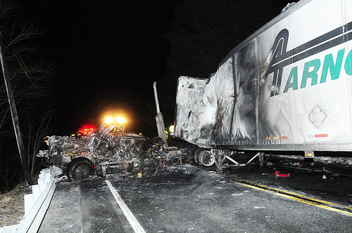 Firefighters respond to the scene of a fiery crash Tuesday night long SR895 in East Brunswick township. One person was killed in the accident.