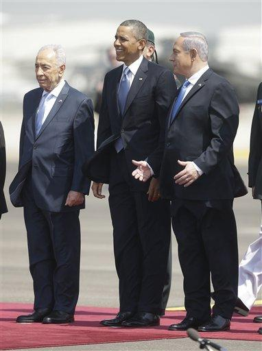 President Barack Obama is greeted by Israeli President Shimon Perez, left, and Israeli Prime Minister Benjamin Netanyahu upon his arrival ceremony at Ben Gurion International Airport in Tel Aviv, Israel, on Wednesday.