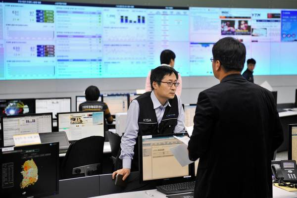Members of the Korea Internet Security Agency (KISA) check on cyber attacks at a briefing room of KISA in Seoul. The South Korean military raised its cyber attack warning level after computer networks crashed at major TV broadcasters and banks, with initial suspicions focused on North Korea.