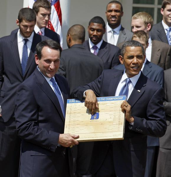 This 2010 photo shows President Obama looking over the NCAA basketball tournament bracket with Duke Coach Mike Krzyzewski.