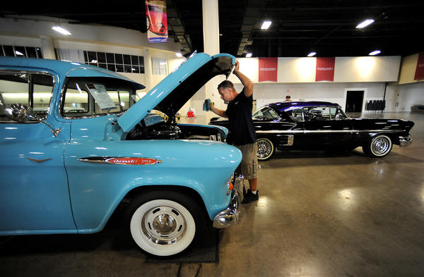 A 1957 Chevy gets the once over from detailer Rick Bishop, of Bishop's Restoration Tuesday afternoon at the Broward County Convention Center, where this weekend Auctions America will hold it's Fort Lauderdale Collector Car Auction.