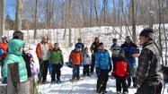 On a bright, sunny Sunday, more than 50 people gathered to listen to Doug Craven talk of native methods of making maple syrup.