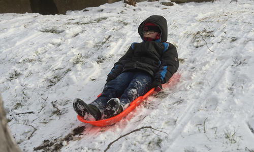Steven Rodriquez, 9, glides down a small hill near his home at 22nd and Liberty Streets in west Allentown on Sunday, December 30, 2012.