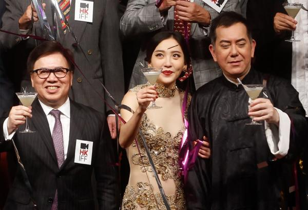 Hong Kong International Film Festival Society Chairman Wilfred Wong, left, Chinese actress Zhou Chu Chu, center, and Hong Kong actor Anthony Wong raise glasses during the opening ceremony of 37th Hong Kong International Film Festival.