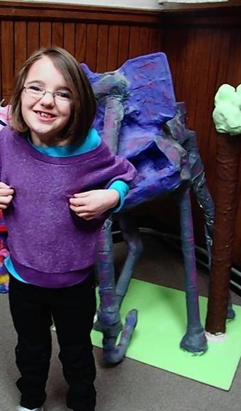 "Hailey Dunbar, 9, Libertyville, took one year to create her sculpture, ""Pinata the Elephant."" Art therapist Julie Ludwick sees the piece as a metaphor for the empowering benefits of art in special needs children's lives."