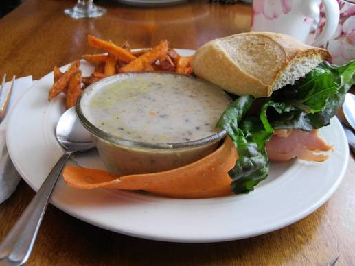 Half in the Bag special is soup, sweet potato fries and a turkey sandwich on half of a baguette.