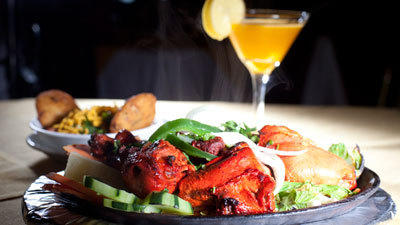 The tandoori chicken at Mirchi Wok is marinated overnight in yogurt, cumin cream cheese, ginger and Indian spices.