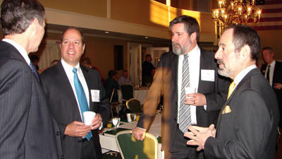 Pennsylvania Department of Environmental Protection Secretary Michael Krancer talking to people before the Eggs & Issues breakfast sponsored by the Somerset County Chamber of Commerce. From left: Tim Rigby of U.S Rep. Keith Rothfus office; attorney Vincent Barbera; Les Brilhart of Somerset Trust; and Krancer.
