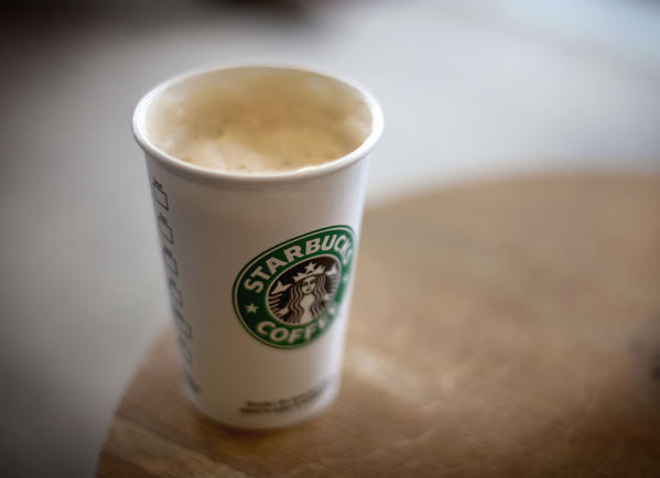 Starbucks expands its loyalty program, buys its first coffee farm and talks acquisitions in its annual investor meeting.