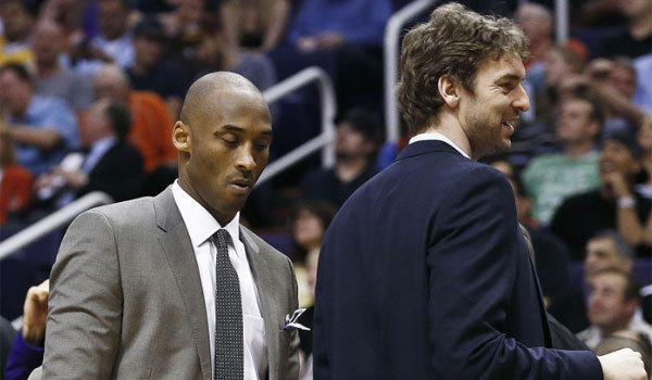 Injured Lakers stars Kobe Bryant, left, and Pau Gasol were in street clothes as their teammates took on the Phoenix Suns on Monday.