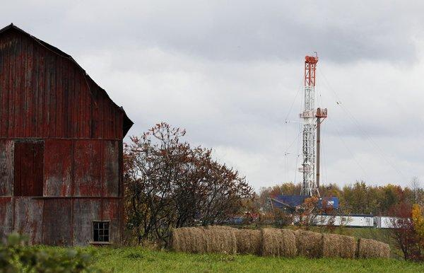 A drilling rig is set up near a barn in Springville, Pa., to tap gas from the Marcellus Shale.