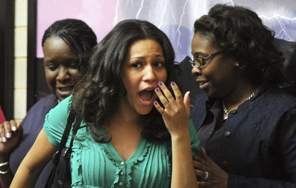 Kyla Sullivan of Columbia is surprised after being announced a winner of the second home lottery during the Howard County Housing Fair at Long Reach High School in Columbia, Md., on Saturday, April 14, 2012.