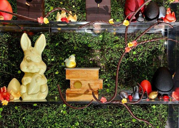An Easter bunny sculpted of white chocolate is among the good-enough-to-eat creatures in a holiday display at L'Atelier de Joel Robuchon at MGM Grand.
