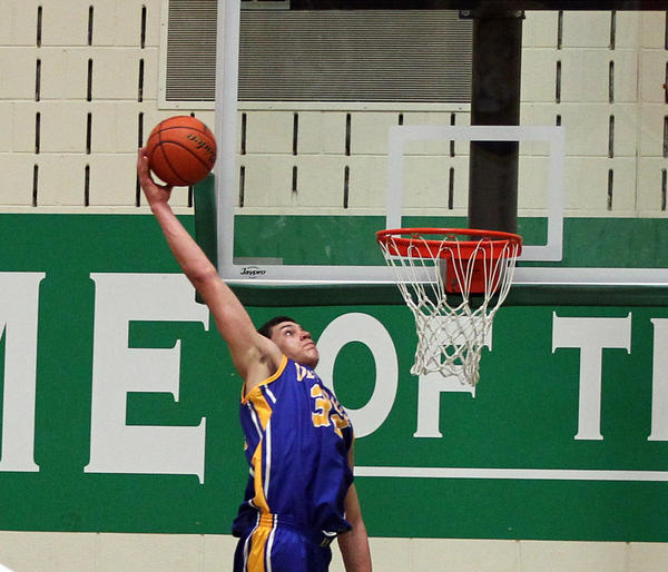 De La Salle's Gavin Schilling attempts a dunk in the Jack Tosh Holiday Classic championship basketball game at York High School on Dec. 30, 2011.