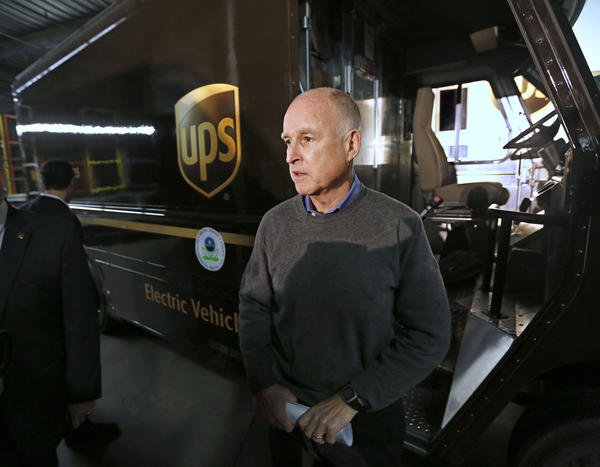 Gov. Jerry Brown talks to reporters after inspecting an electric-powered UPS delivery truck last month.