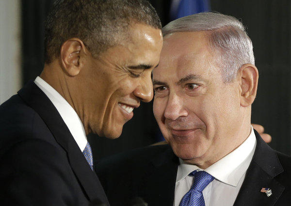 President Obama and Israeli Prime Minister Benjamin Netanyahu huddle during their joint news conference in Jerusalem.
