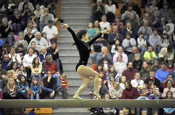 Caite Fleming performs on the balance beam at the University of Maryland's Gymkana Troupe show at Hagerstown Community College's ARCC