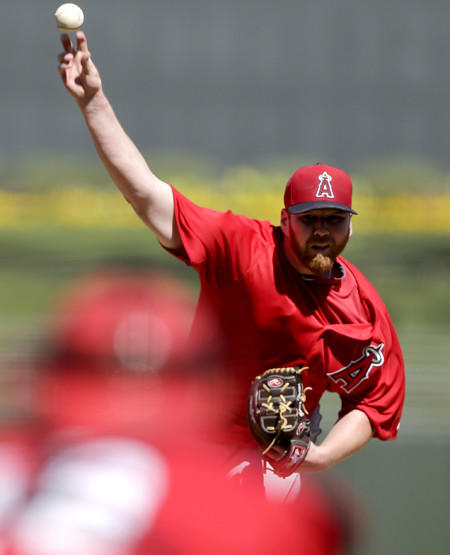 Angels starter Tommy Hanson pitches against the Kansas City Royals in an exhibition game earlier this month.