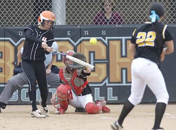 Huntington Beach High's Sammie Vandiver pops a base hit into left field against Cerritos on Monday.