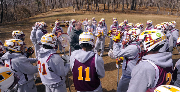 Hereford boys lacrosse coach Brian King, center, brings his team together before practice.