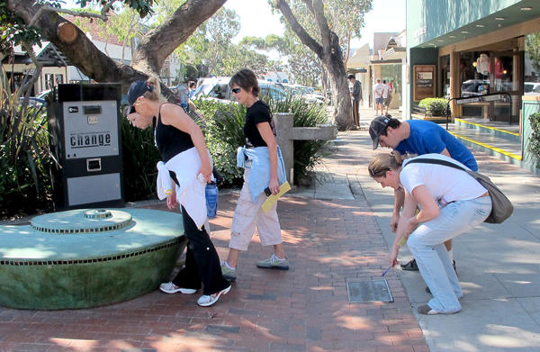 Teams search downtown Laguna for clues in last year's Laguna Beach Art Adventure.