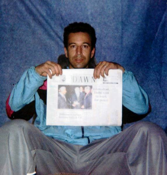 Wall Street reporter Daniel Pearl displays a newspaper during his captivity by Pakistani militants in January 2002. He was beheaded the following month.