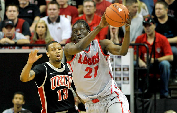 New Mexico guard Tony Snell receives a pass as he cuts to the basket against UNLV's Bryce DeJean-Jones in the championship game of the Mountain West Conference tournament.
