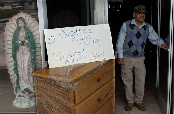 "Furniture store owner Enrique Martinez put a sign outside his store saying ""Justice Come Today -- Congrats City of Bell"" just hours after the guilty verdicts were announced during the corruption trial of former Bell Mayor Oscar Hernandez and five former council members."