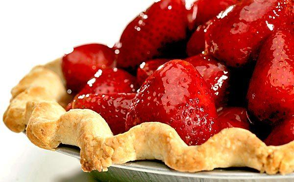 "Who can resist a fresh strawberry pie? <a href=""http://www.latimes.com/features/food/la-fo-fruitpierecb-20100722,0,742824.story"">Click here for the recipe.</a>"