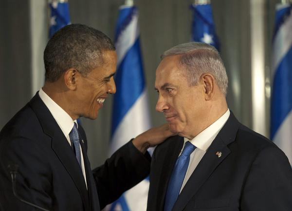 President Barack Obama, left, pats the shoulder of Israeli Prime Minister Benjamin Netanyahu during a joint news conference in Jerusalem, Israel.