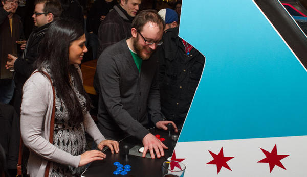 Gamers try out the Indie City Arcade cabinet during the February launch party at Emporium Arcade Bar.