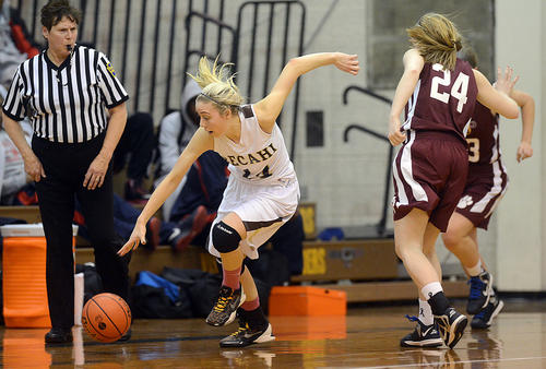 Bethlehem Catholic's Nicole Lacherza (left) picks up a loose ball in front of  Bonner - Prendergast's Amber Ballinger (right) in the first round of the PIAA 3A girls basketball tournament Saturday at Allen High School.