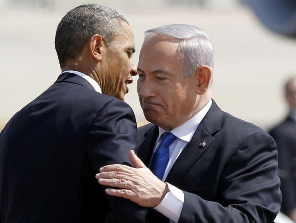 Israeli Prime Minister Benjamin Netanyahu greets President Barack Obama at Ben Gurion International Airport in Tel Aviv on Wednesday.