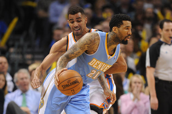 Mar 19, 2013; Oklahoma City, OK, USA; Denver Nuggets forward Wilson Chandler (21) handles the ball against Oklahoma City Thunder guard Thabo Sefolosha (2) during the second half at Chesapeake Energy Arena. Mandatory Credit: Mark D. Smith-USA TODAY Sports
